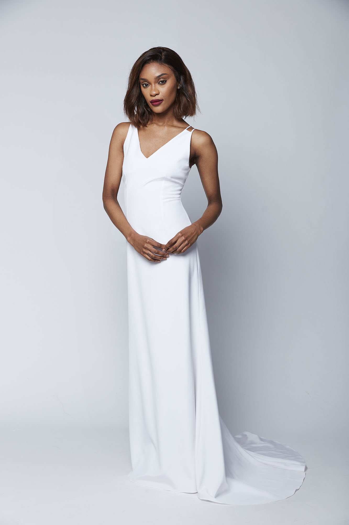 Designed with romantic brides in mind, this form fitting gown with double straps and dramatic train is sure to turn heads as you walk down the aisle.