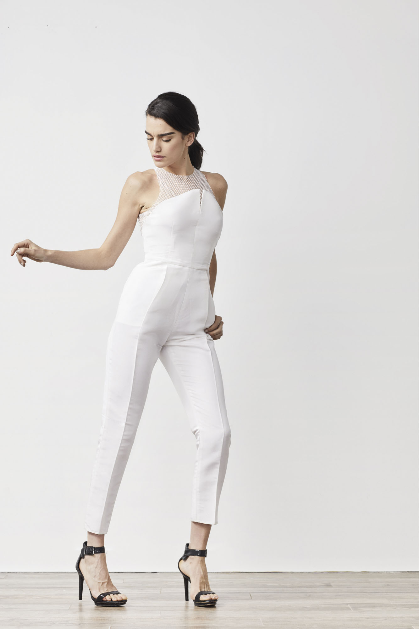 The Italian Neoprene Sonia jumpsuit featuring luxe Italian lace and an angled bodice is the perfect option for modern brides wanting an alternative look for their wedding day .