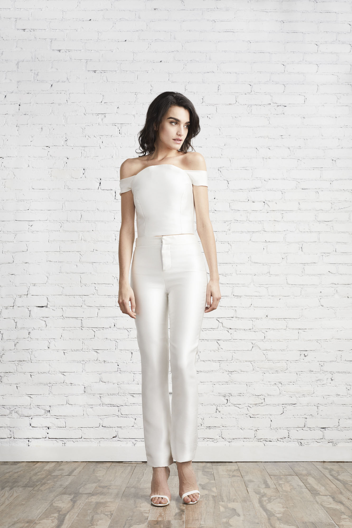 The Eva off the shoulder top in Italian Neoprene has delicate sleeves and matches back beautifully to the Julia cigarette pant—a perfect look for the power bride.