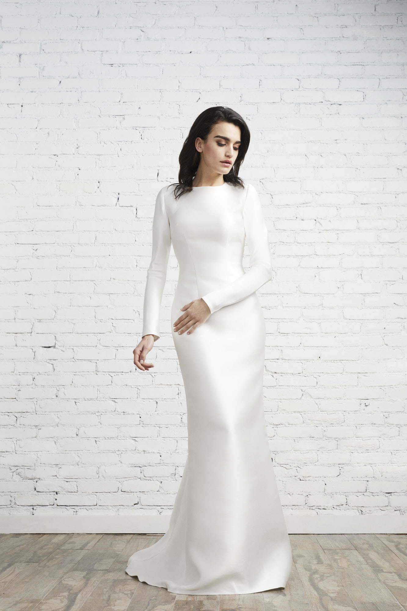 Equal parts edgy and modern, the long sleeve Bella gown has a wide open back and is designed for the sophisticated woman seeking an ultra-fitted look.