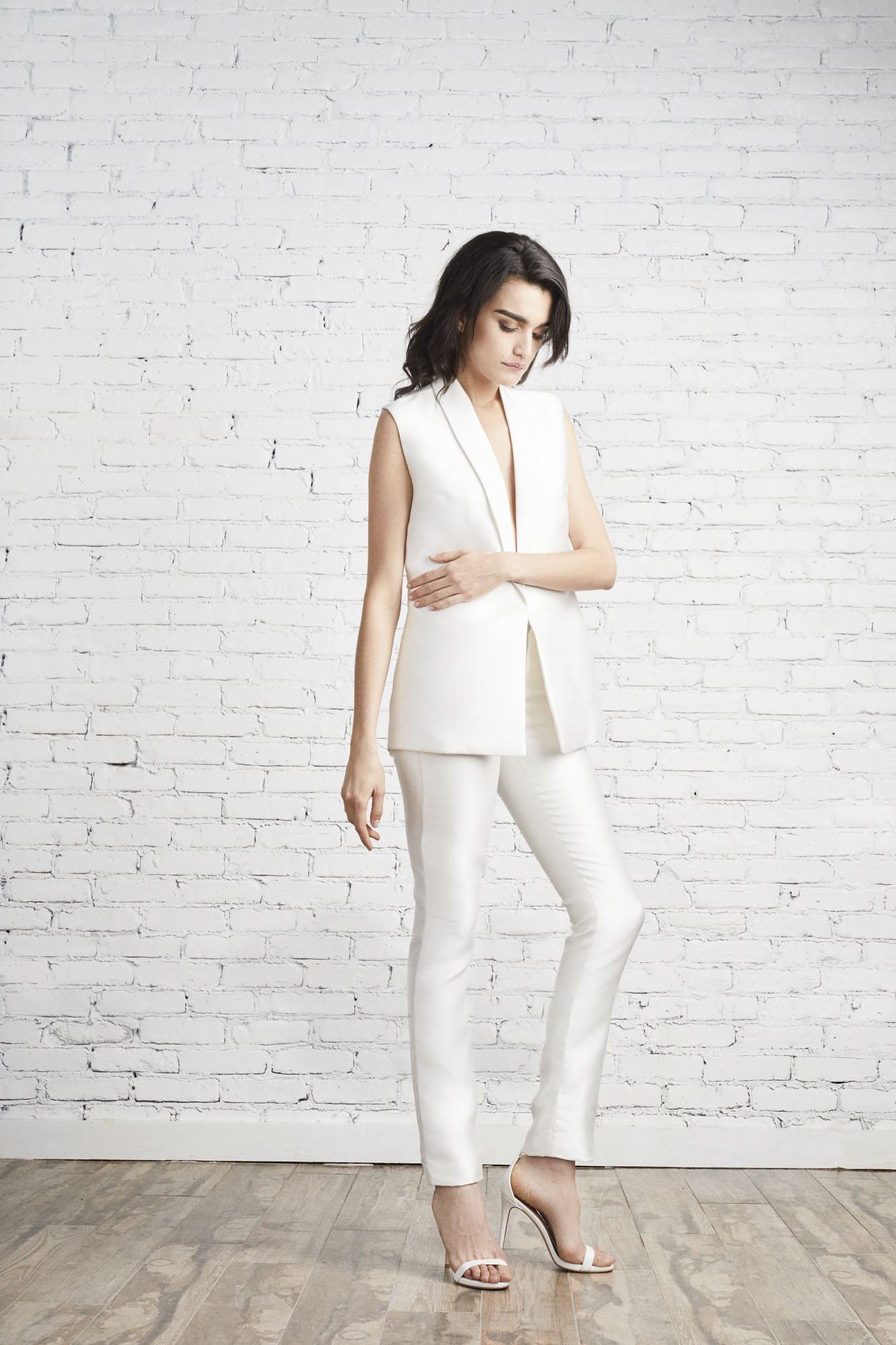 The Carmen sleeveless jacket and Julia cigarette pant create a sophisticated look perfect for the power bride.