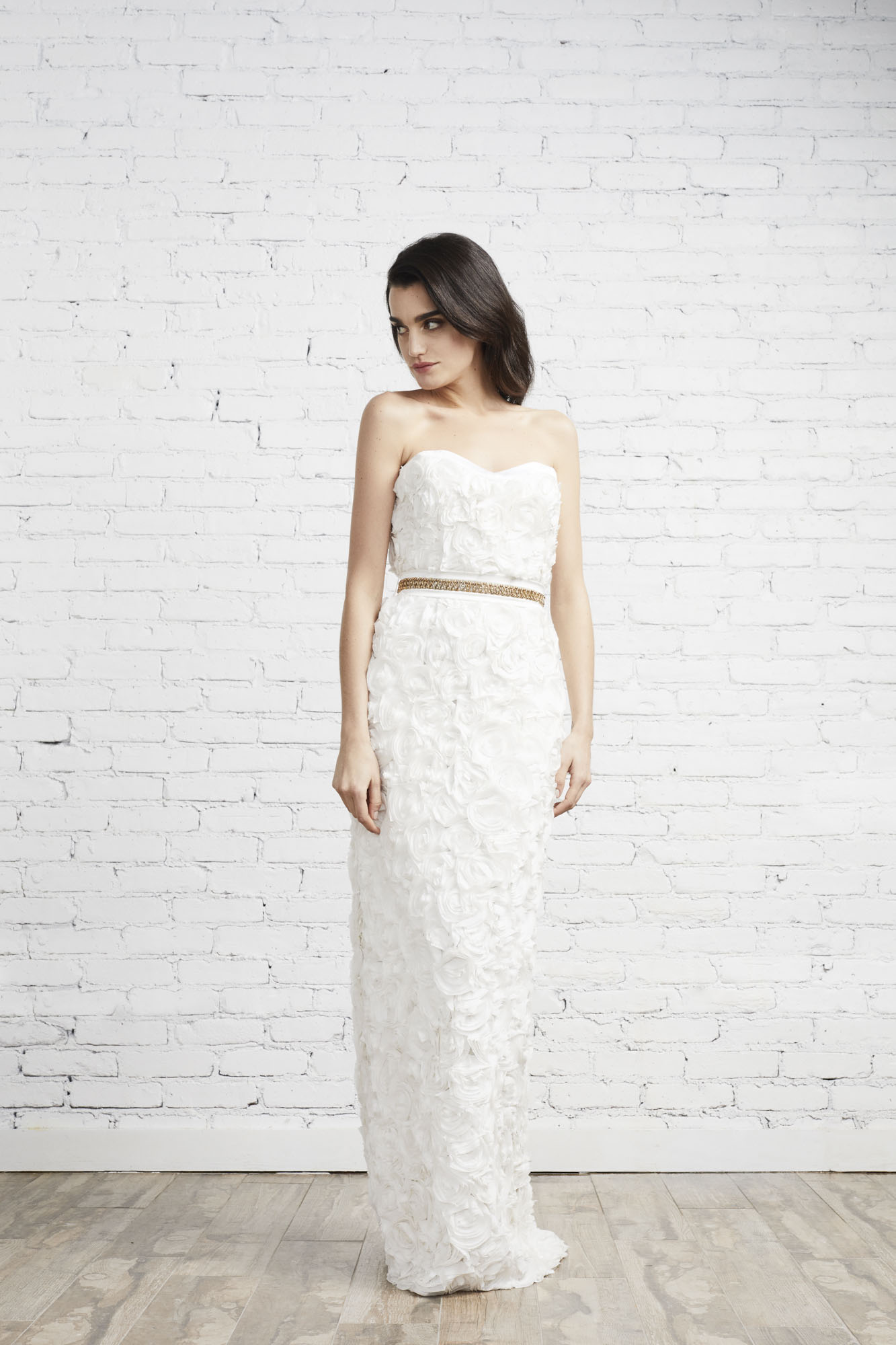 The strapless Sasha gown featuring hundreds of individually embroidered silk rosettes is perfect for the bride who is going for a look that is both ultra-feminine and modern.
