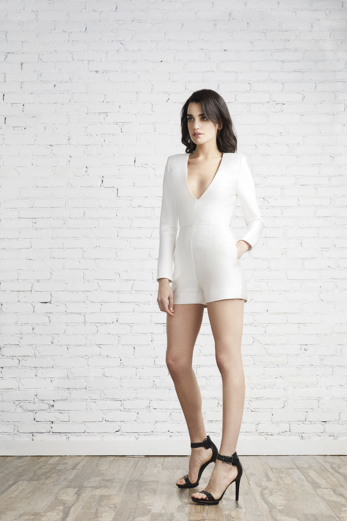 The Kayla long sleeve romper featuring a plunging neckline and custom Italian Neoprene will be worn again well after the wedding day.