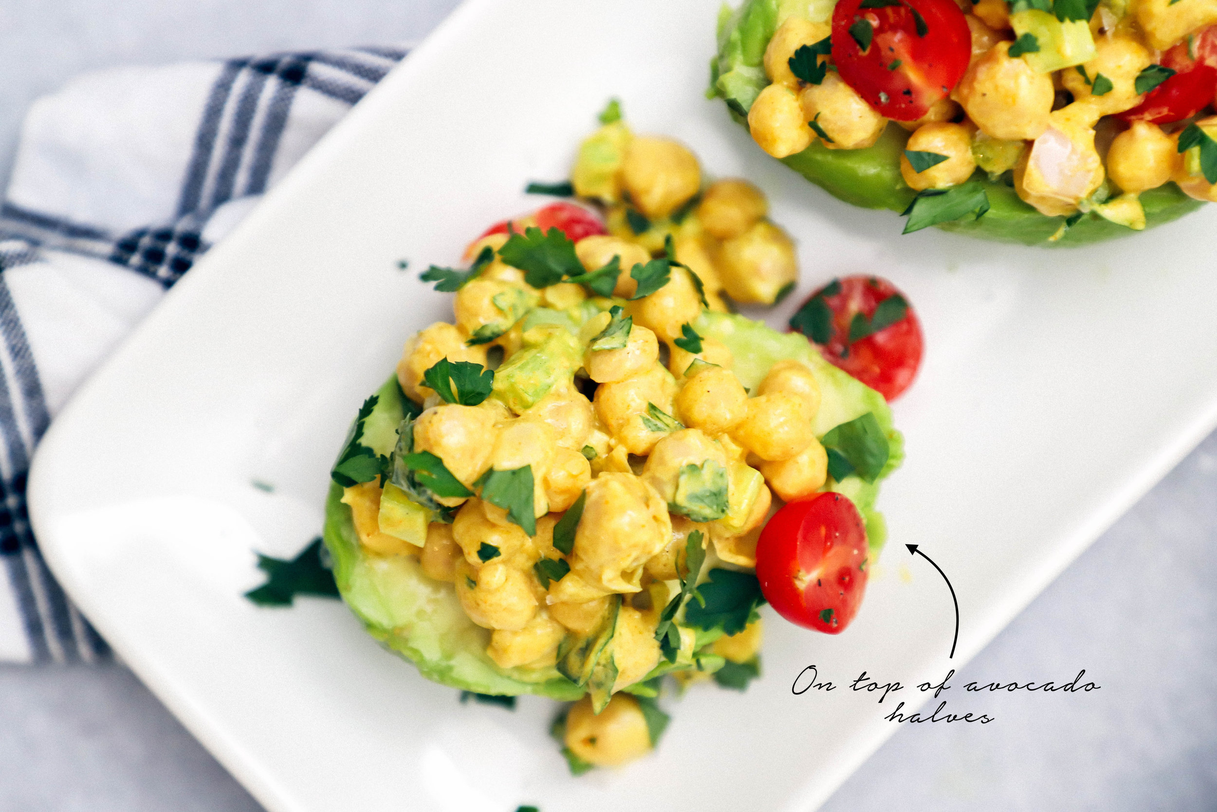 curried chicpea salad on top of avocado havles
