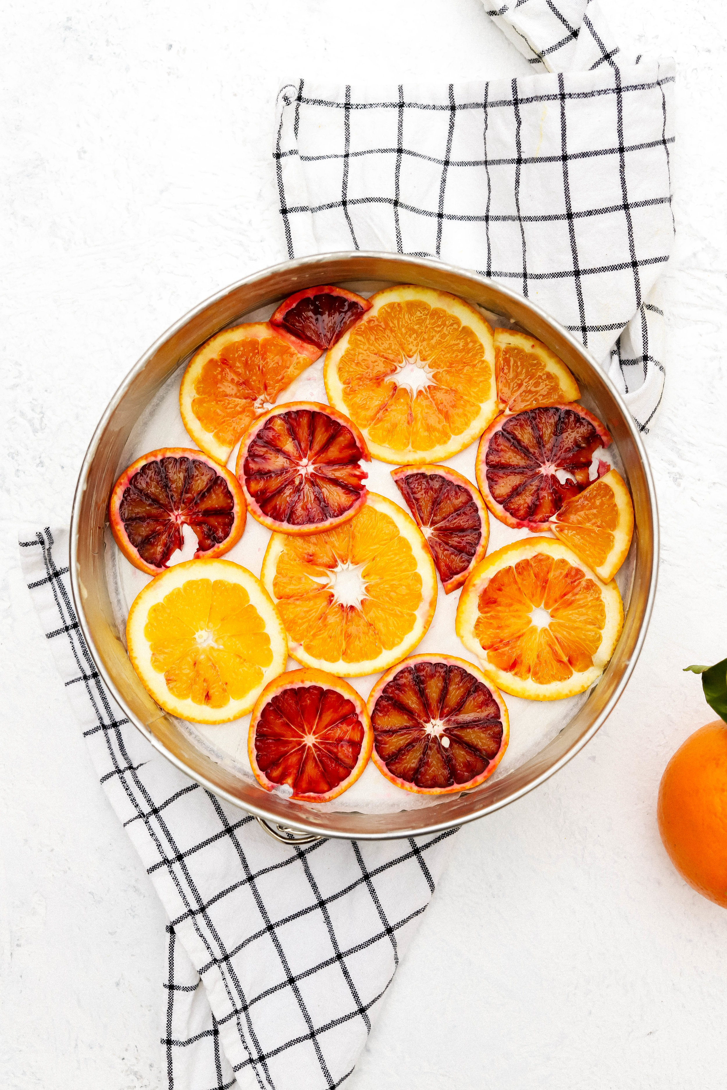 sliced oranges at the bottom of a spring form pan