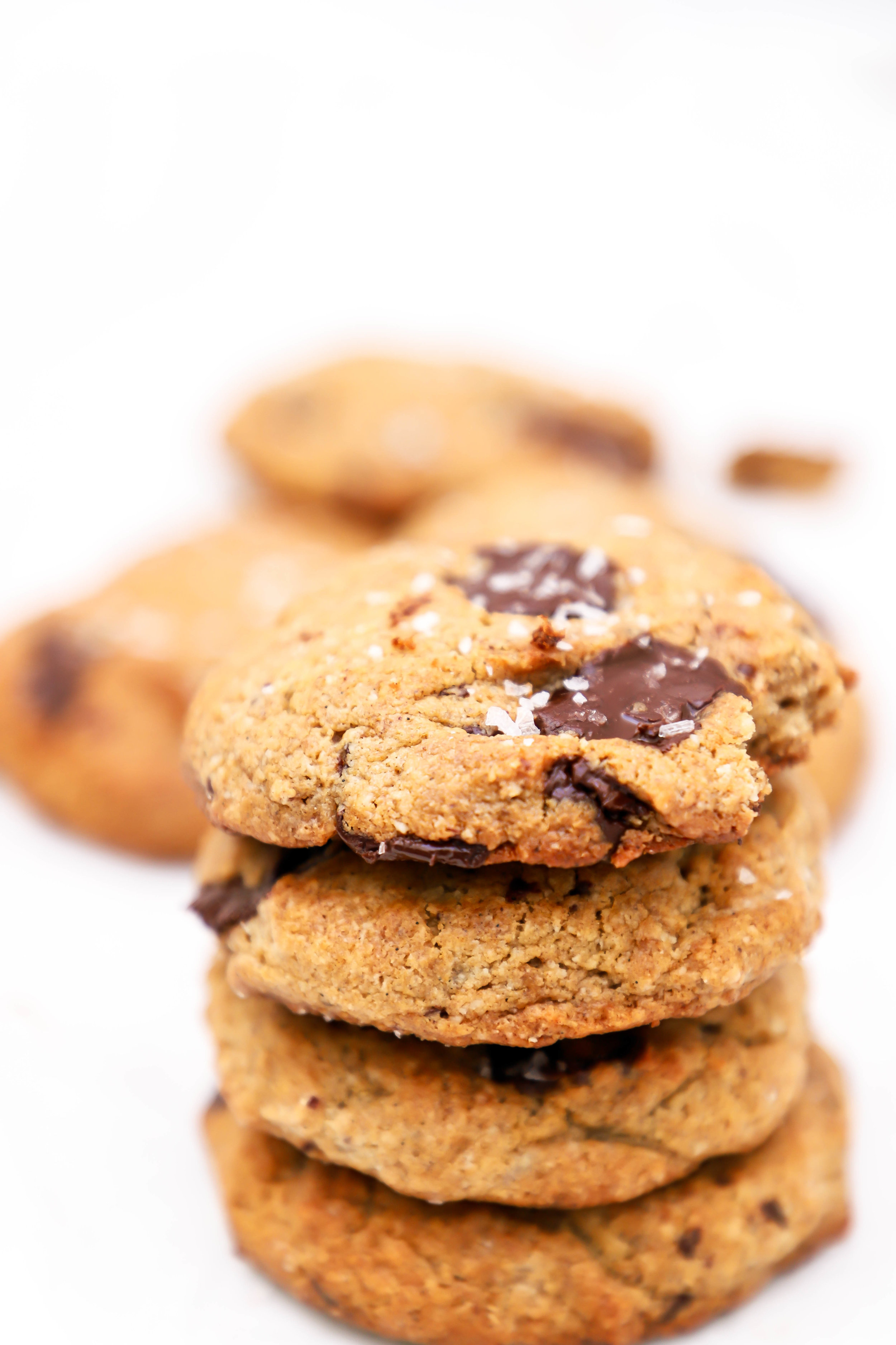 vegan and gluten-free chocolate chip cookies with tahini and coconut oil, stacked on top of each other