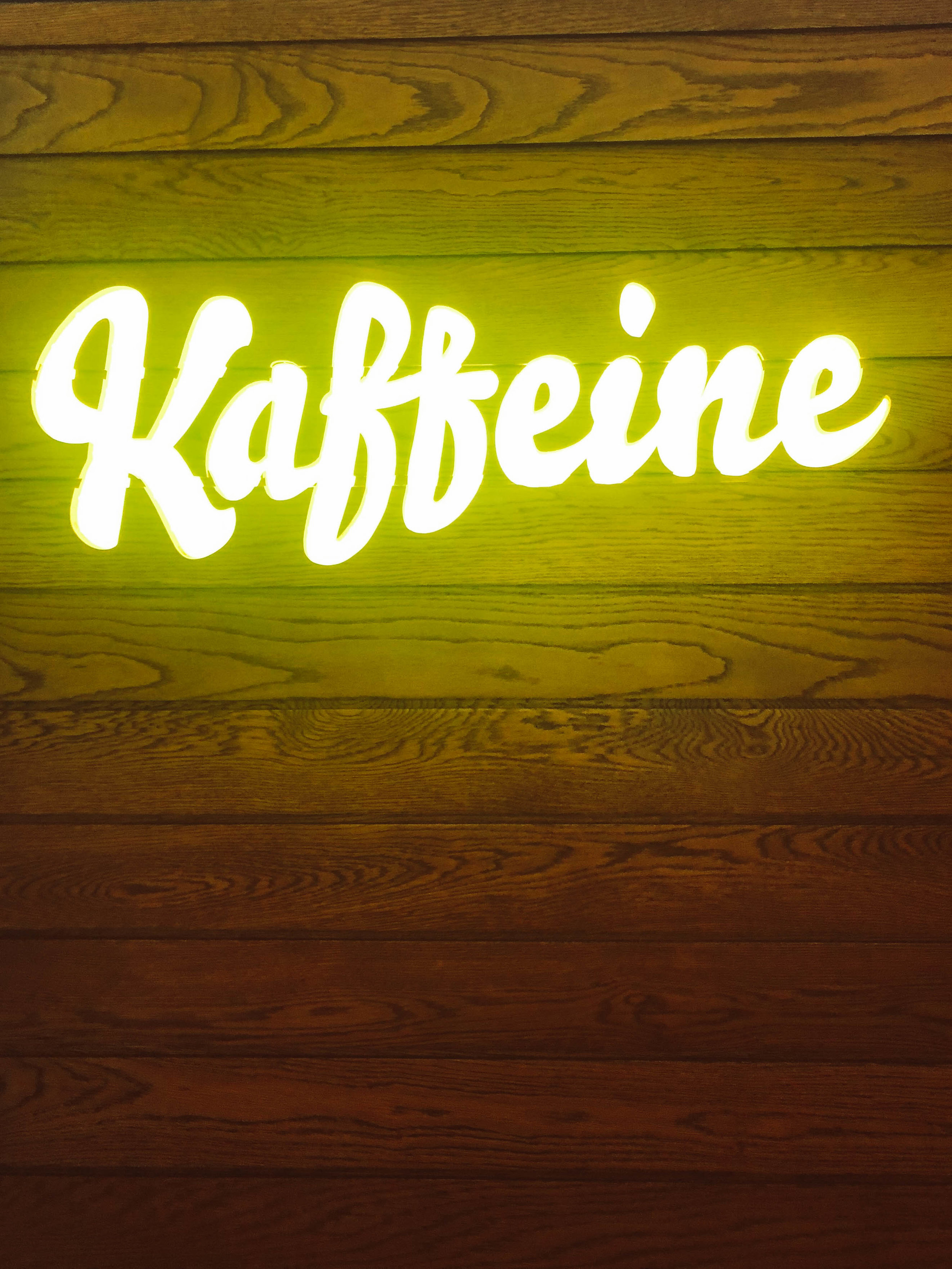 neon sign at Kaffeine in London