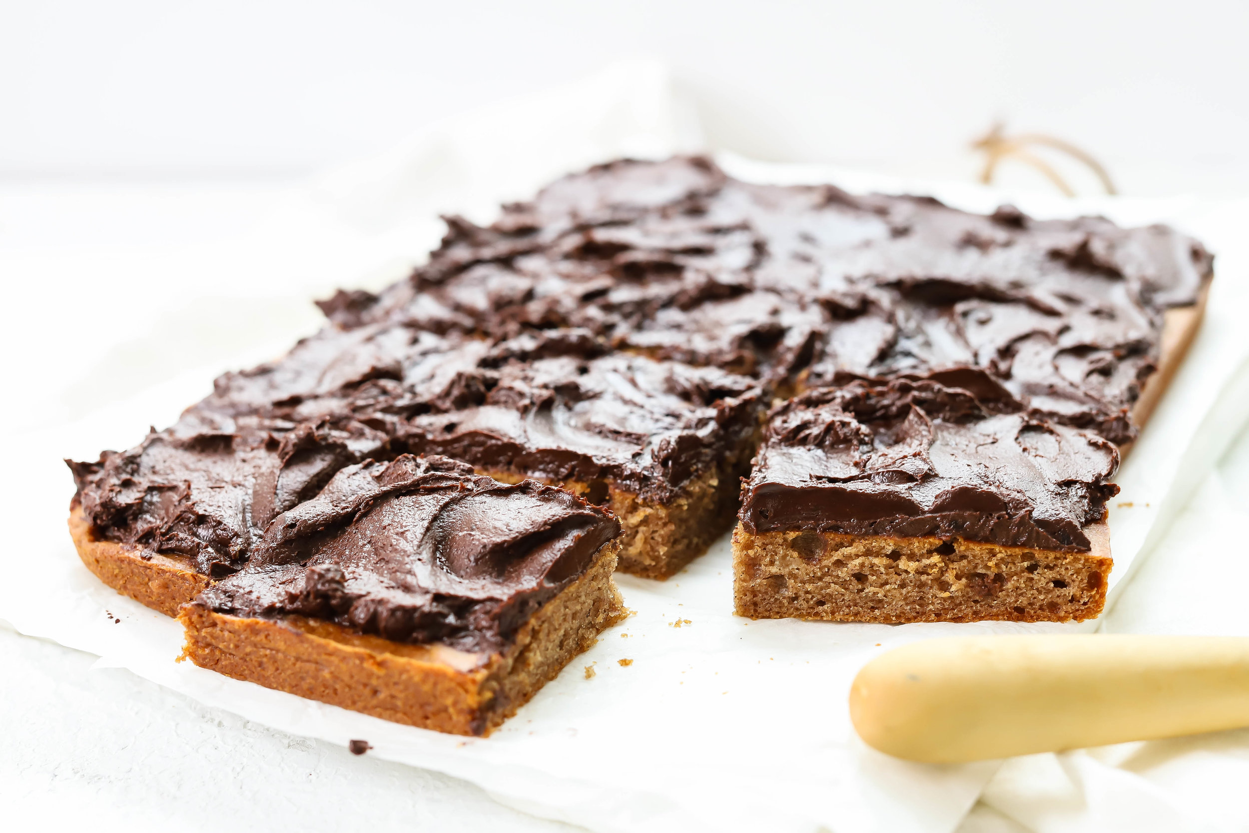 Vegan and gluten-free sheet cake with chocolate frosting