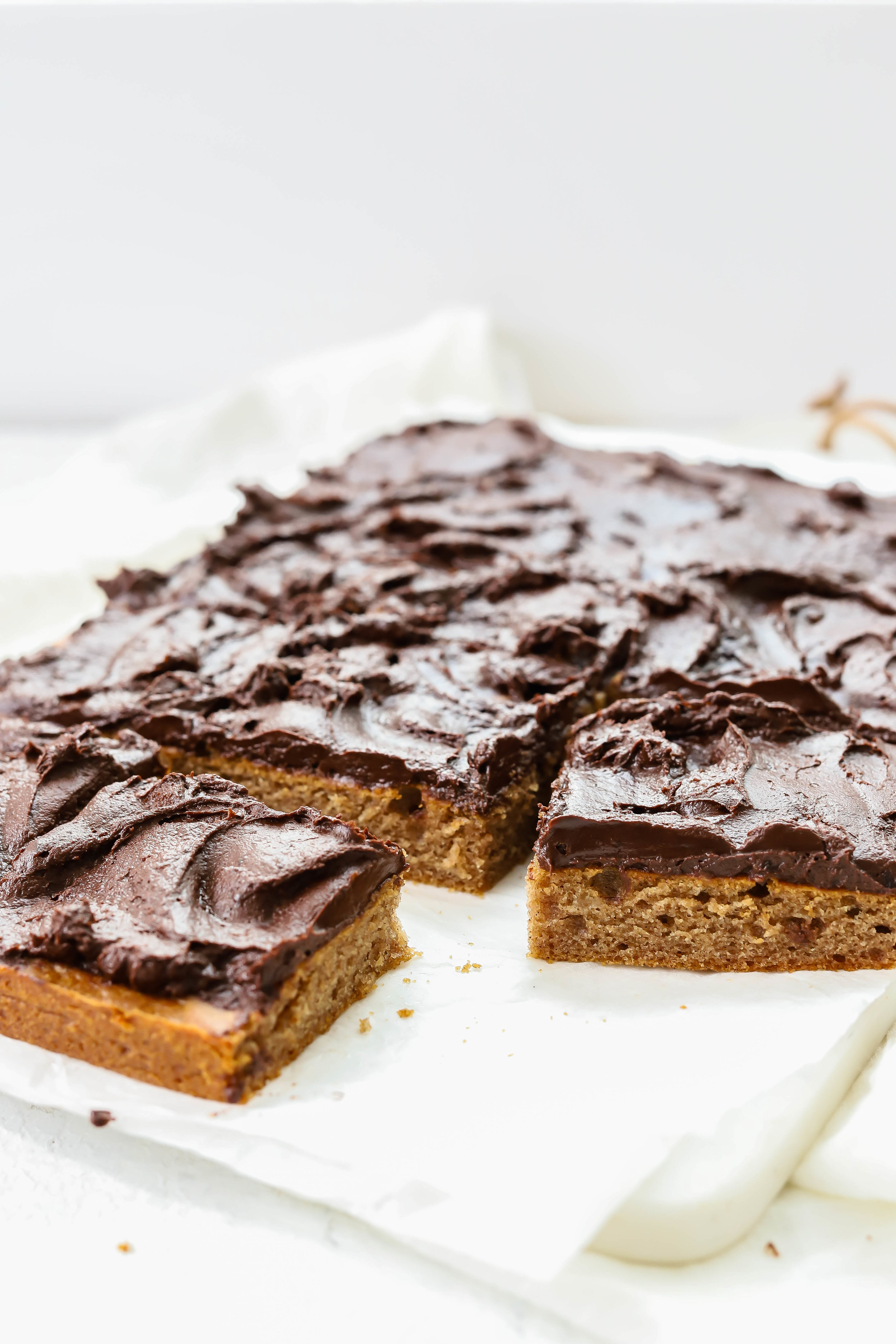 Vegan and gluten-free sheet cake with rich chocolate frosting and sweetened with dates.