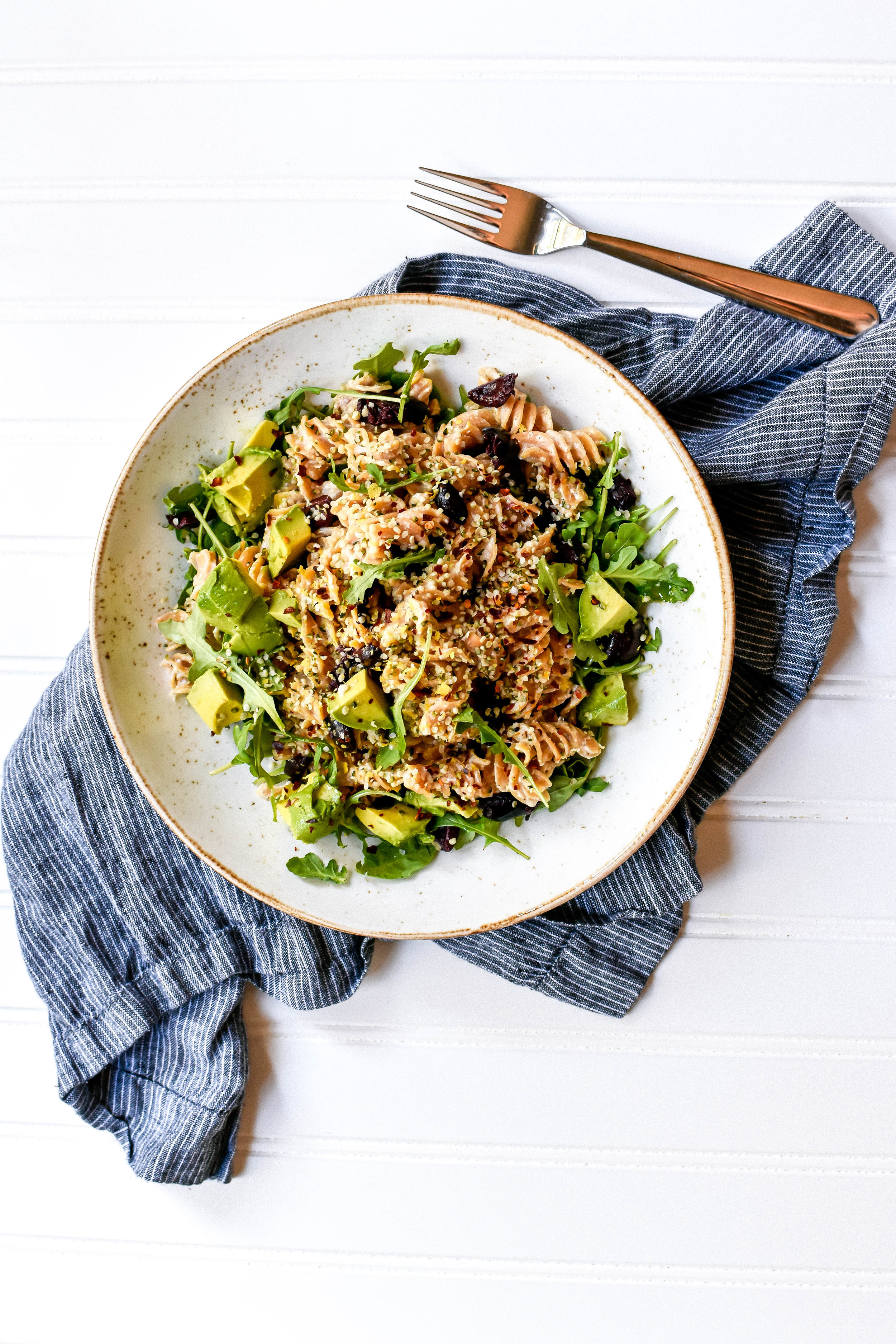simple lentil pasta in white bowl with napkin underneath