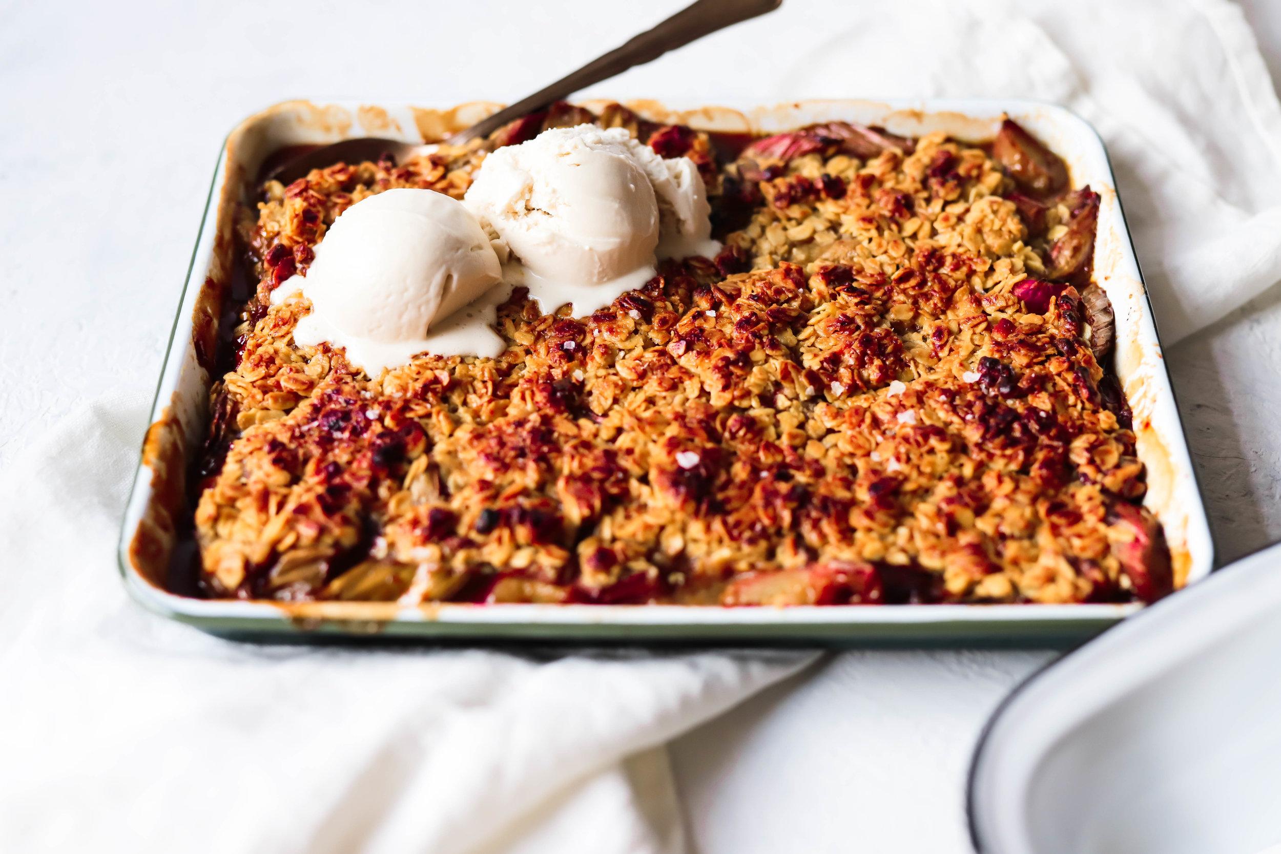 vegan and gluten-free rhubarb crisp with ice-cream on top