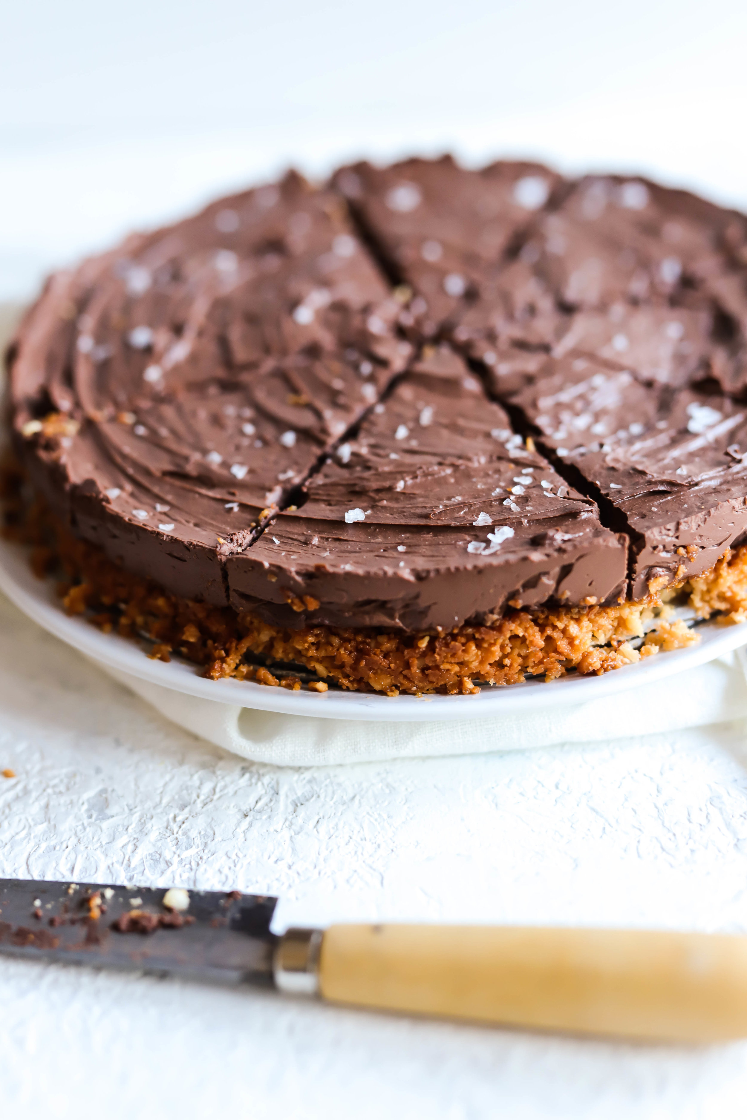 vegan and gluten-free chocolate pie sliced with flakes of sea salt on top