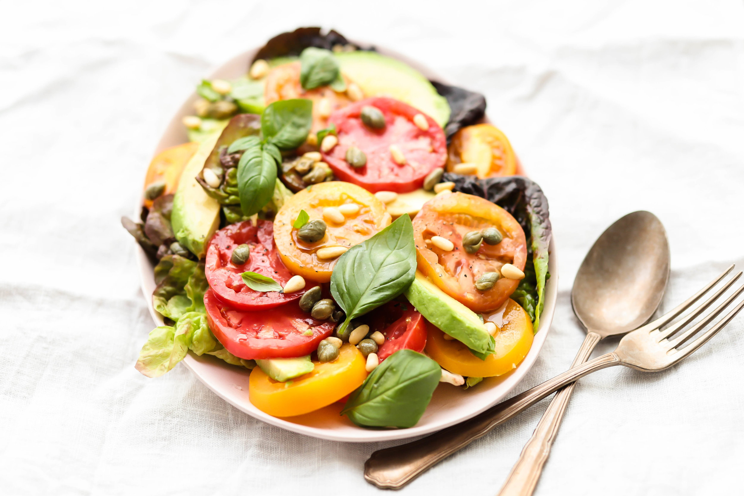 simple heirloom tomato salad on a platter
