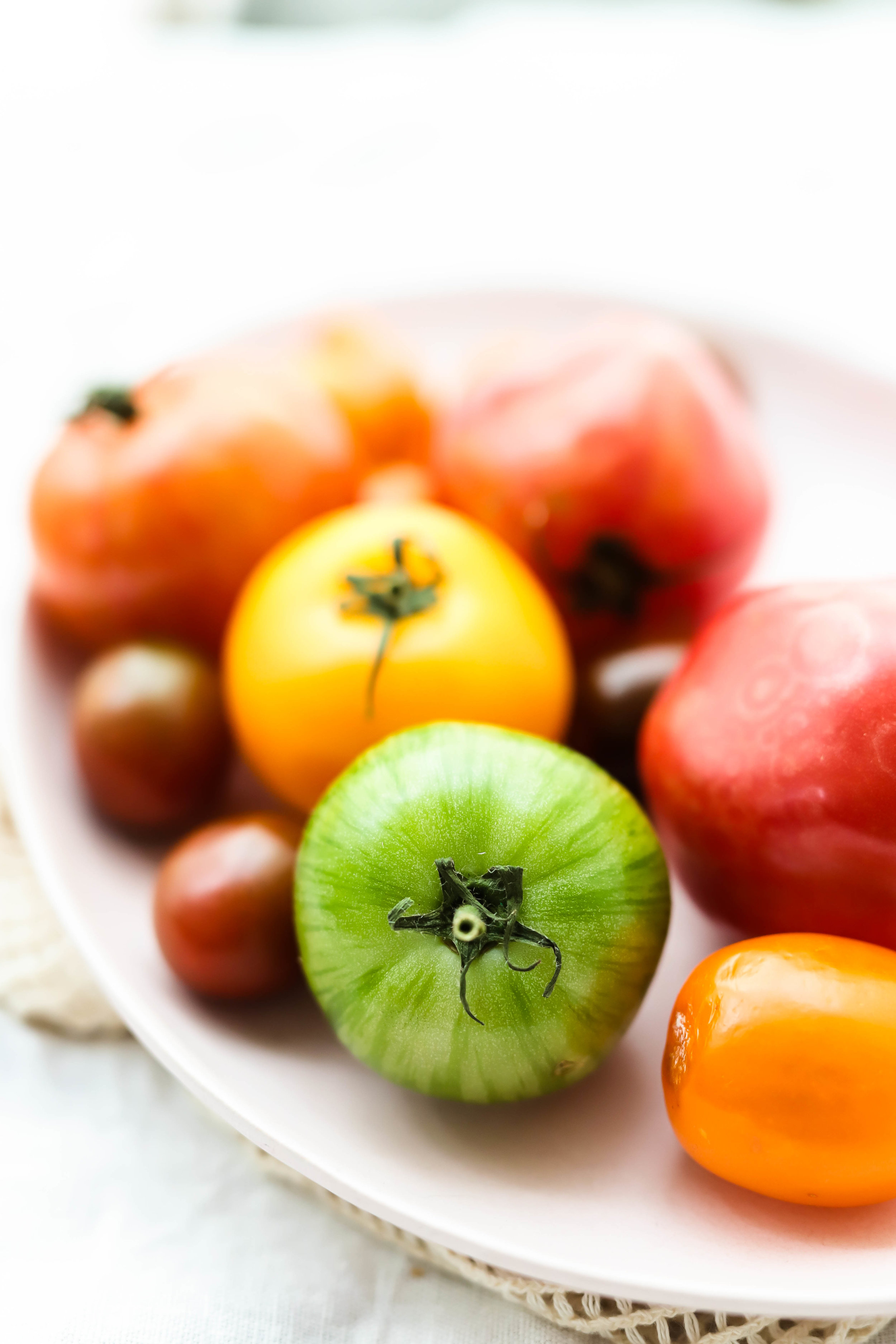 Heirloom tomatoes on a pink plate