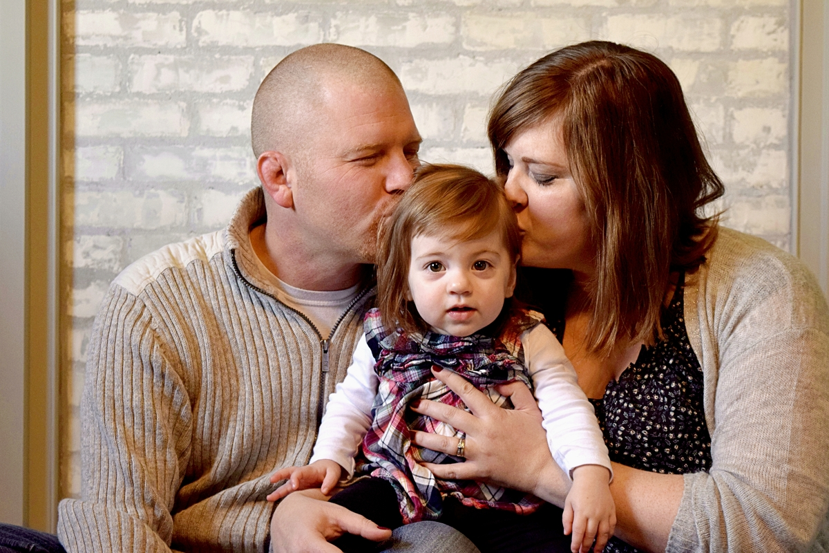Family portrait photography CT NJ NY Mother and Father kissing their child