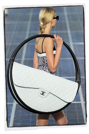 Proof that we're big-bag-batty: This hula-hoop bag by Chanel gained unexpected popularity on Twitter and Instagram, leading major French department store Printemps to purchase some to sell in spring 2014.