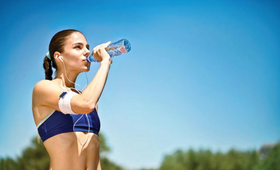 0514-fitness-cover-woman-water-bottle_avlz41.jpg