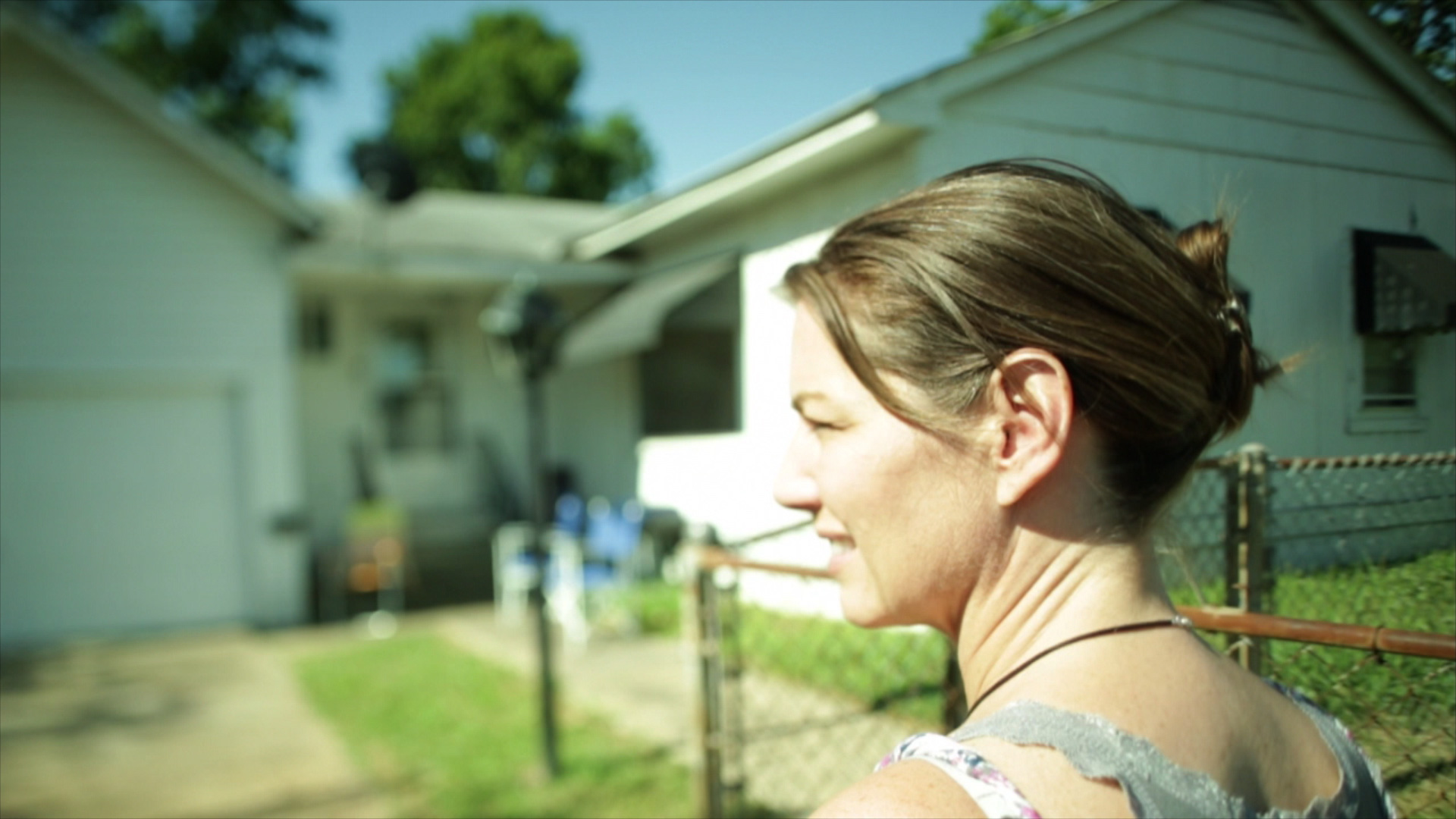 Rebecca visiting the childhood home of her father, Lewis Carpenter, in West Memphis, Arkansas (June 2012)