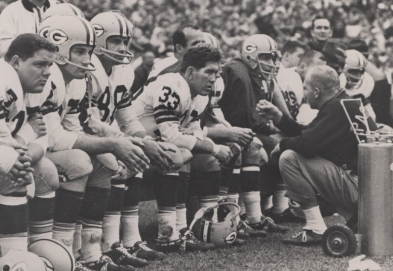 Lewis Carpenter (center) on the sidelines during a Green Bay Packers game.