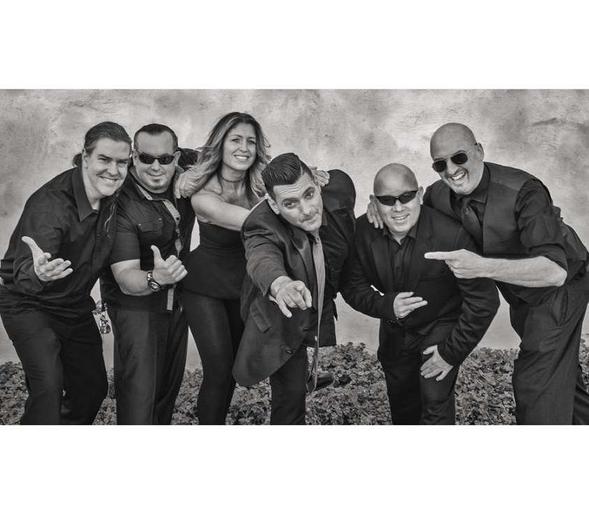 """Members: Dean James Silva - Fronted by / """"Piano Man""""; Lee Nelson - Drums and Vocals; Joseph Cumia - Bass and Vocals; Brian McKeever - Guitars; Annie Moston - Harmonies and Percussion; Doug Leax - Keyboards/Synths/Strings/Sax"""