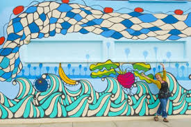 Mural by Cara Murray on downtown grocery store, Market Center.