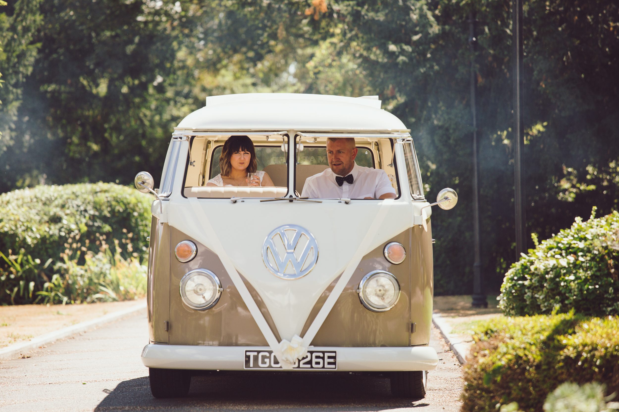 Helen arriving in style at the barns hotel Bedfordshire, moment captured by wedding photographer Richard Puncheon