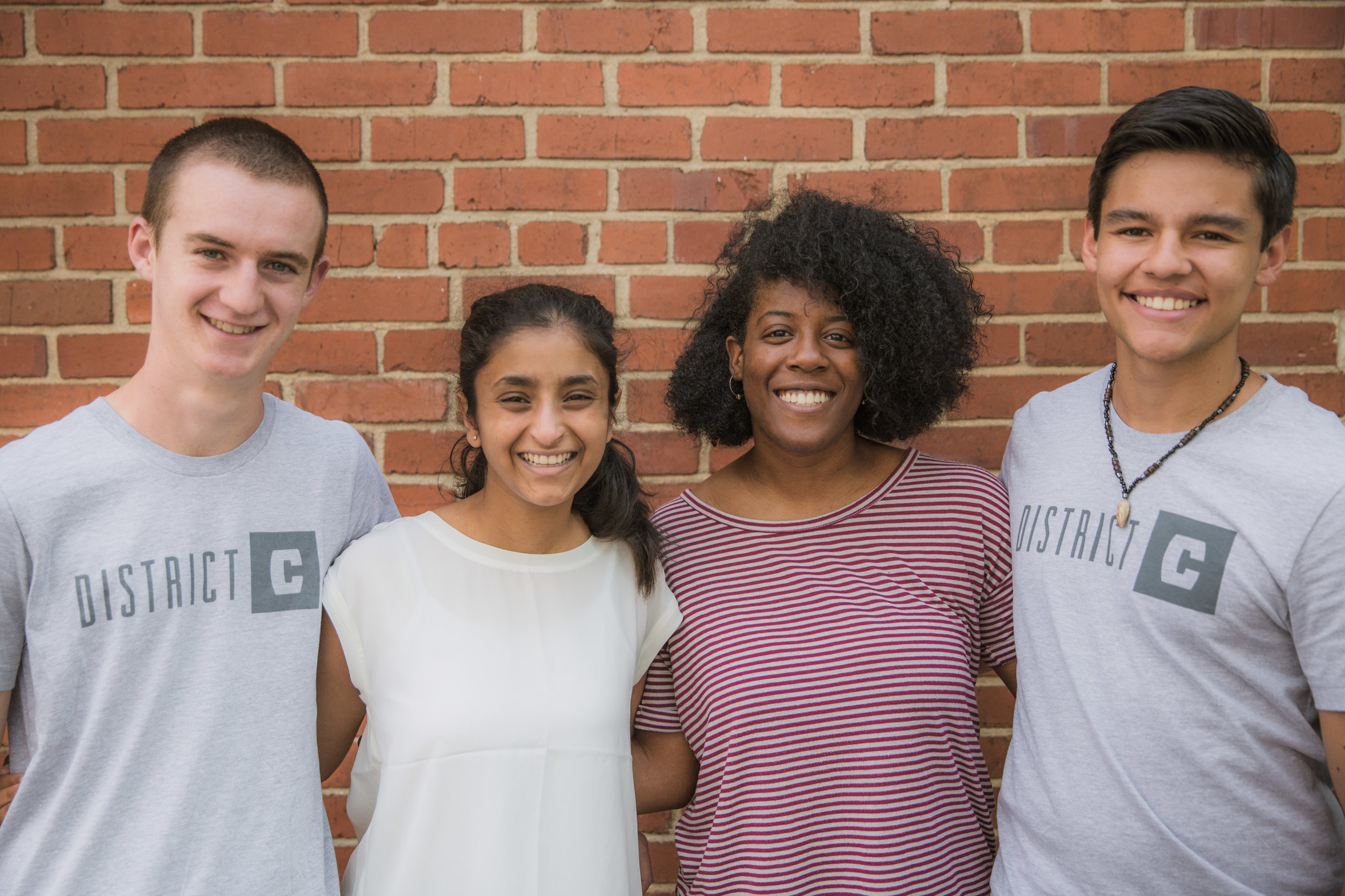 Diverse team of four high school students.