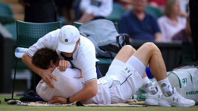 Andy Murray receiving an adjustment mid-match.