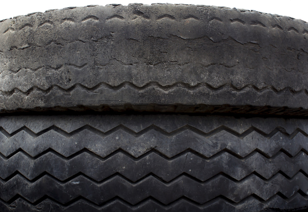 This photo exhibits what abnormal loading can do to tires. There is nothing inherently wrong with the abnormally worn tire, it was just loaded more than the other. Increasing its potential for blowing out sooner.