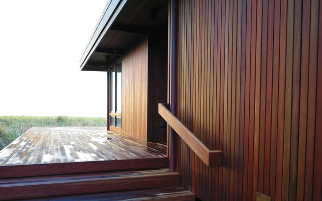 At the front entrance, a long vista extends toward the ocean. Note the details of the ipe handrail to match.