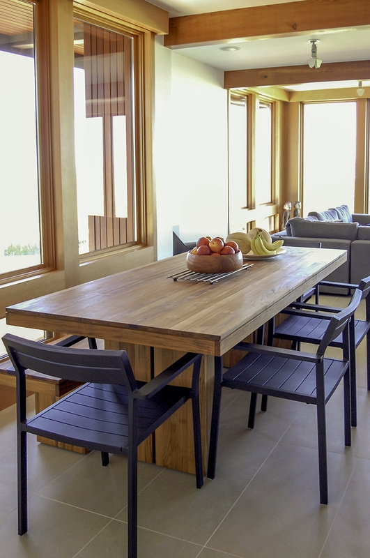The dining room table was chosen from Design Within Reach for the ability to take it outside to the deck for dining—occasionally outdoor furnishings transfer well to the interior of a home.