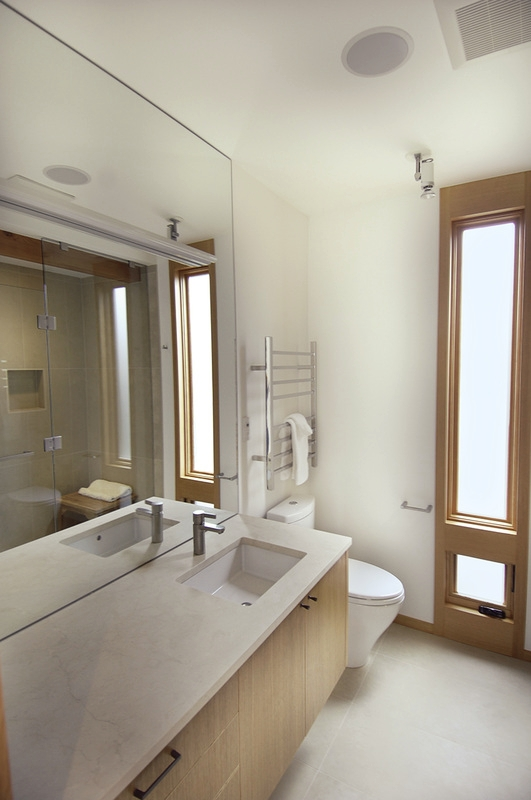 Both bathrooms feature marble countertops, heated towel warmers, and the master bath boasts a steam shower.