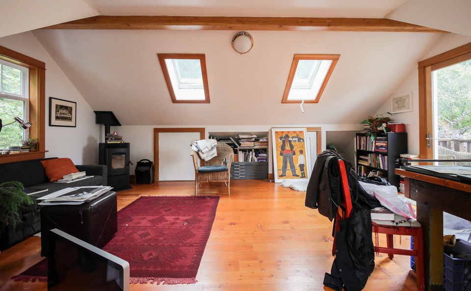 Abundant light was required for this illustration studio. By vaulting the ceilings and adding an abundance of windows, we were able to meet the needs of the artist.