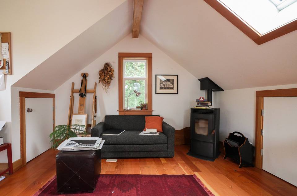 We added storage in the eaves for files and access to art. A free-standing pellet stove adds ambience and heat as needed.