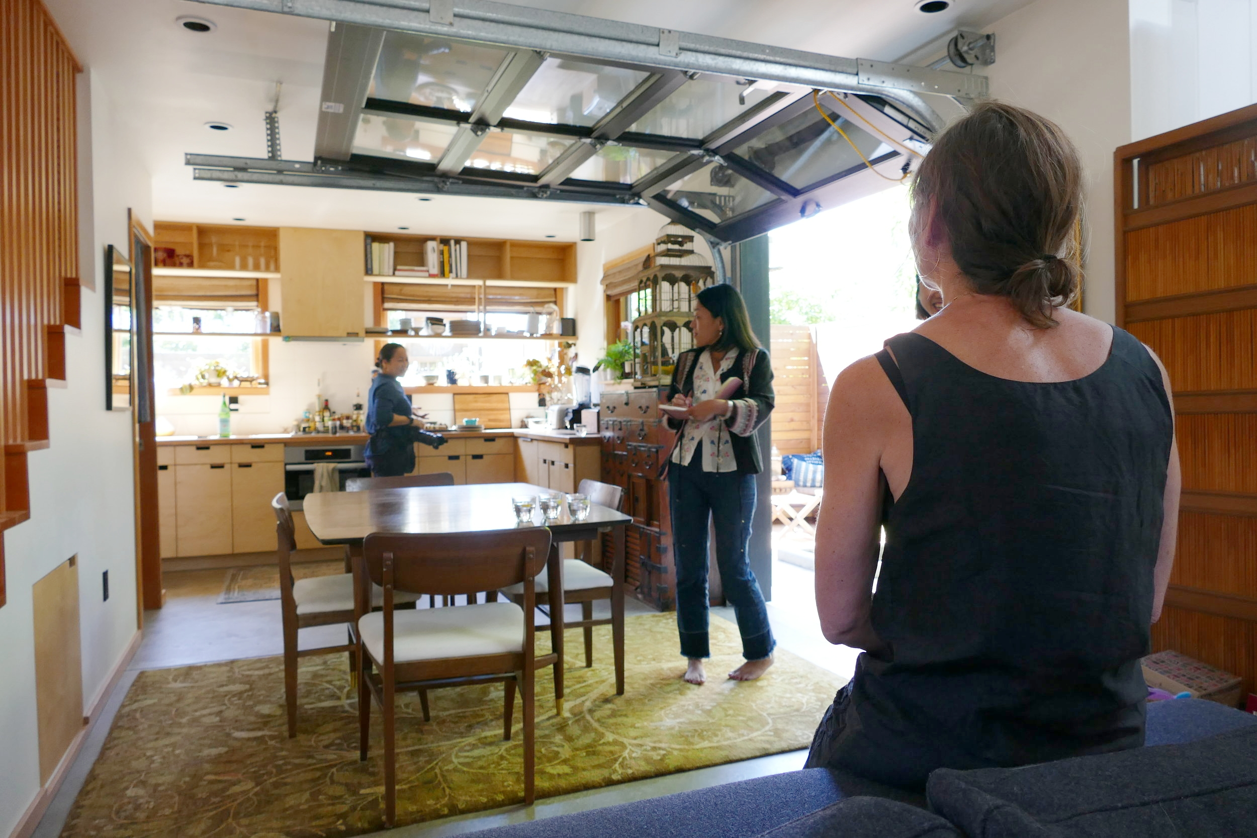 The photographer makes note of kitchen and food items she can use as props for the session while the editor, Megumi,checks her shot list with areas around the property. Shannon patiently waiting to be directed in outfit #1.