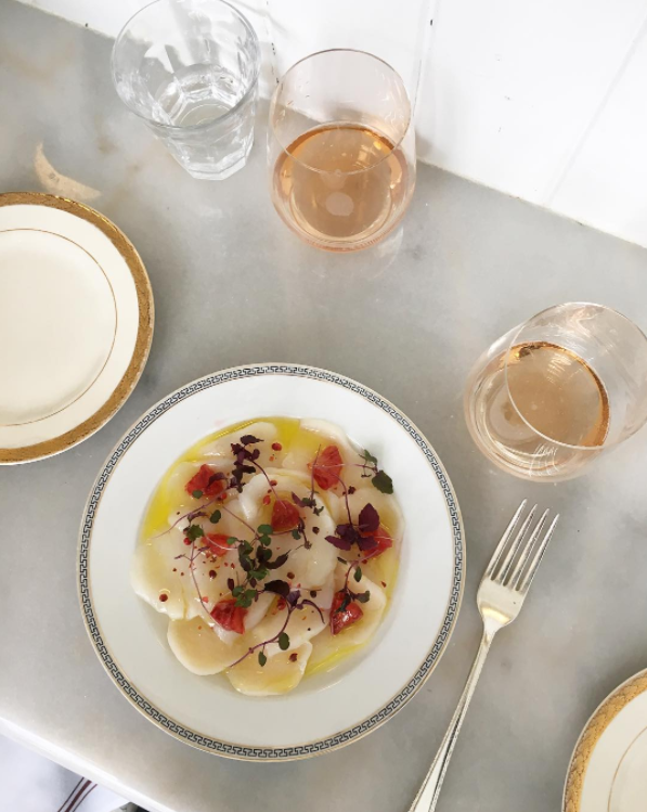 Scallops with blood orange segments, paired with a lovely rosé. Tasteful dining with Duralex glassware, various pieces of vintage china and silverware.