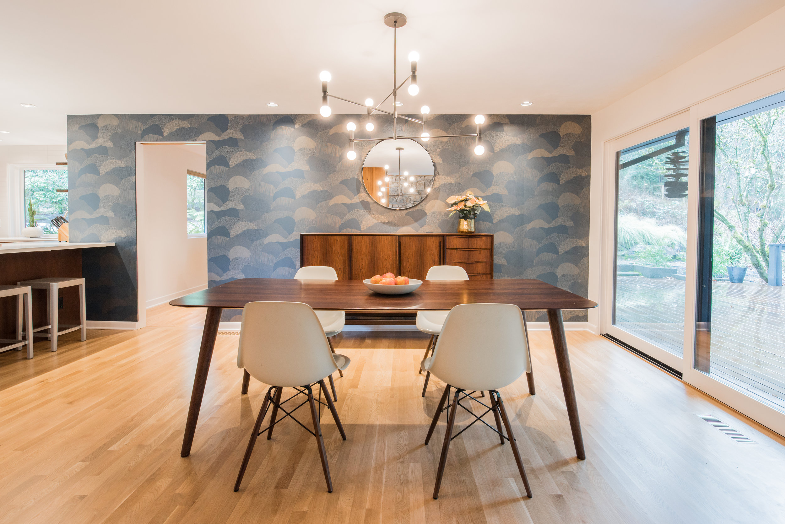 "For the dining room walls, the homeowners chose ""Roll Right - Gold on Blue"" by Makelike, their favorite Portland wallpaper company."