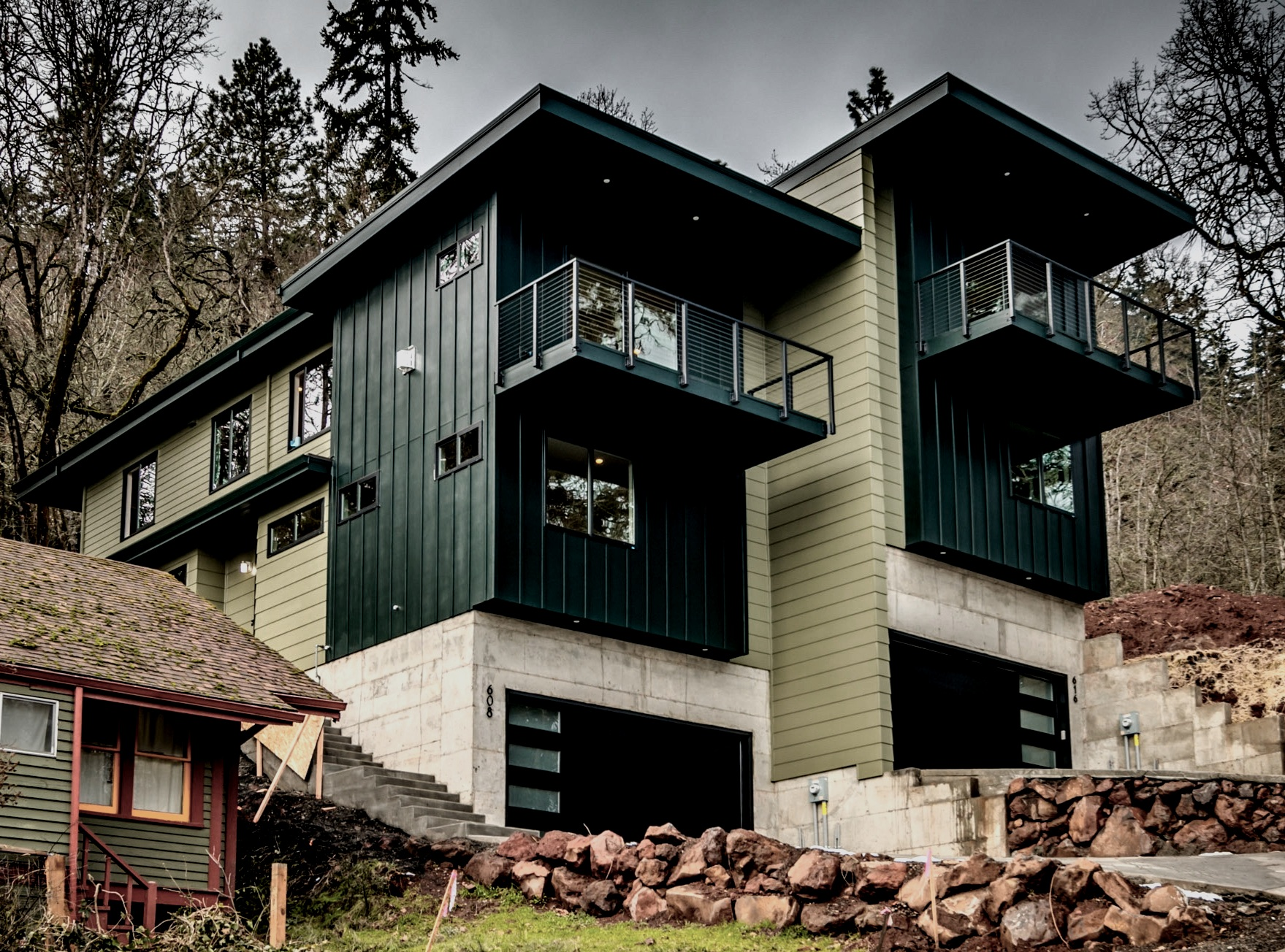 Attached townhomes in White Salmon, Washington. Black Forest Green and Tate Olive by Benjamin Moore were chosen to reflect the natural surroundings.