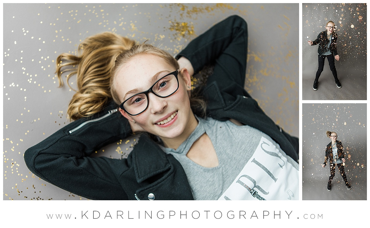 Tween girl with glasses dancing in glitter