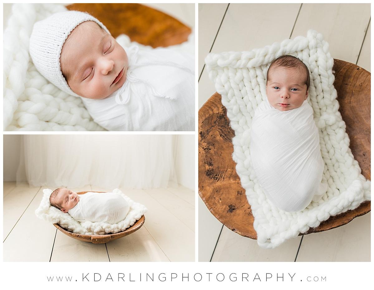 Newborn baby boy in a white bonnet