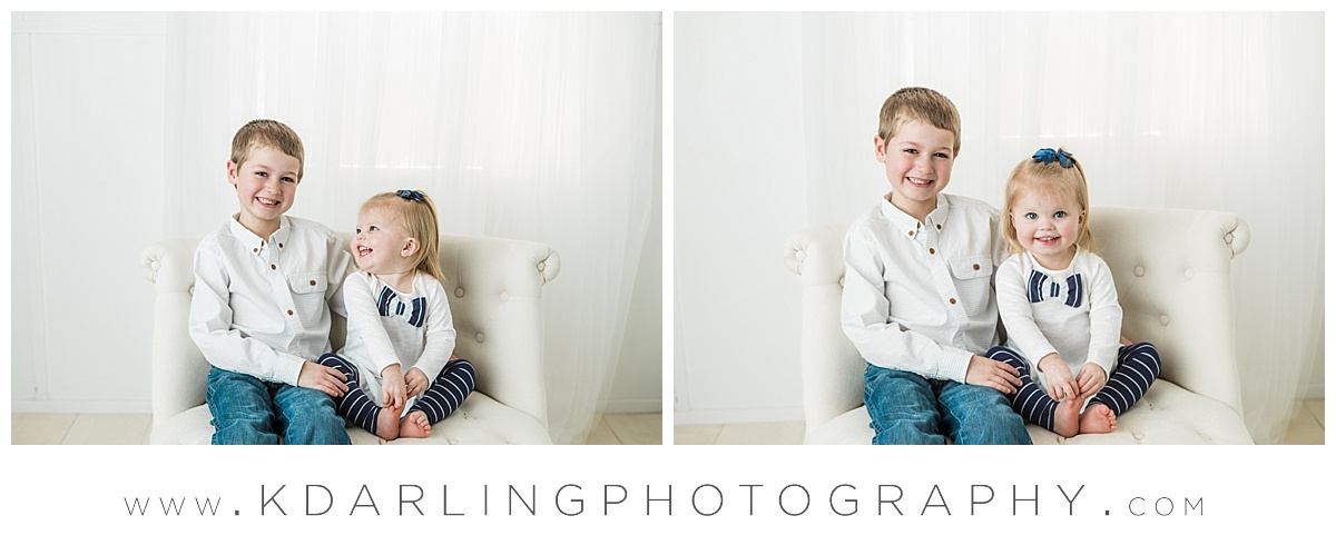 Brother and sister on white couch