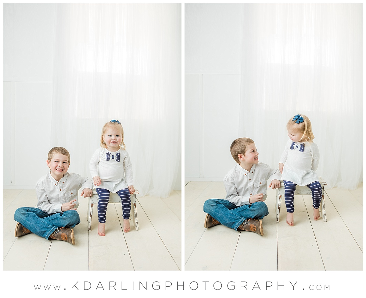 Little sister with big brother in neutral studio