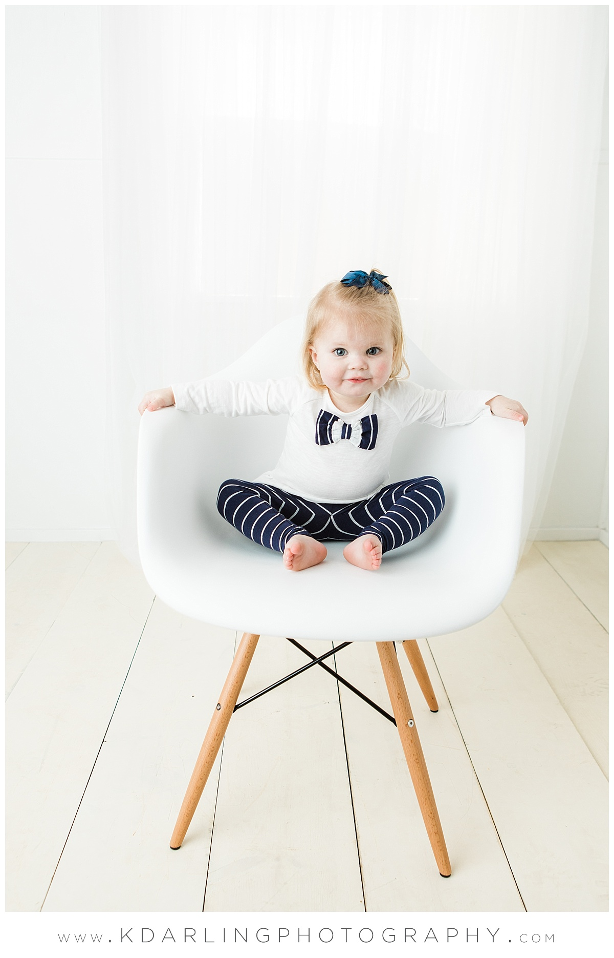 Two year old girl in white chair