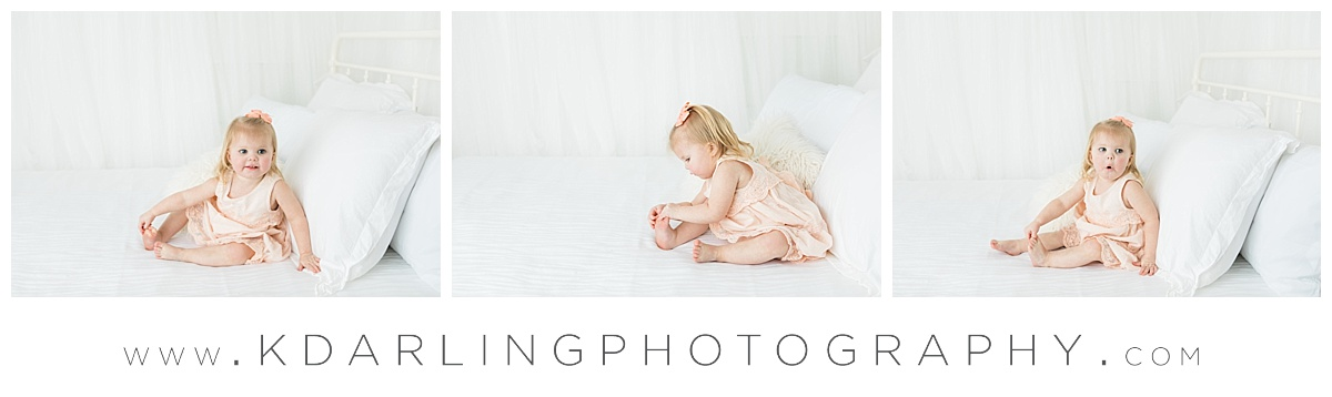 Studio photos on white bed in peach dress
