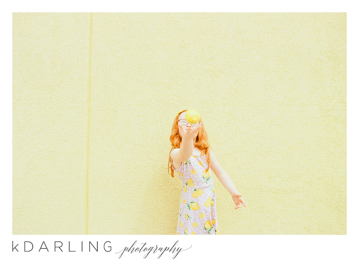 Photo-session-with-yellow-lemons-and-kindergarten-age-girl-downtown-champaign-Il-film-photographer_0014.jpg
