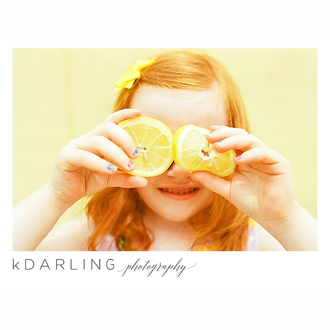 Photo-session-with-yellow-lemons-and-kindergarten-age-girl-downtown-champaign-Il-film-photographer_0001.jpg
