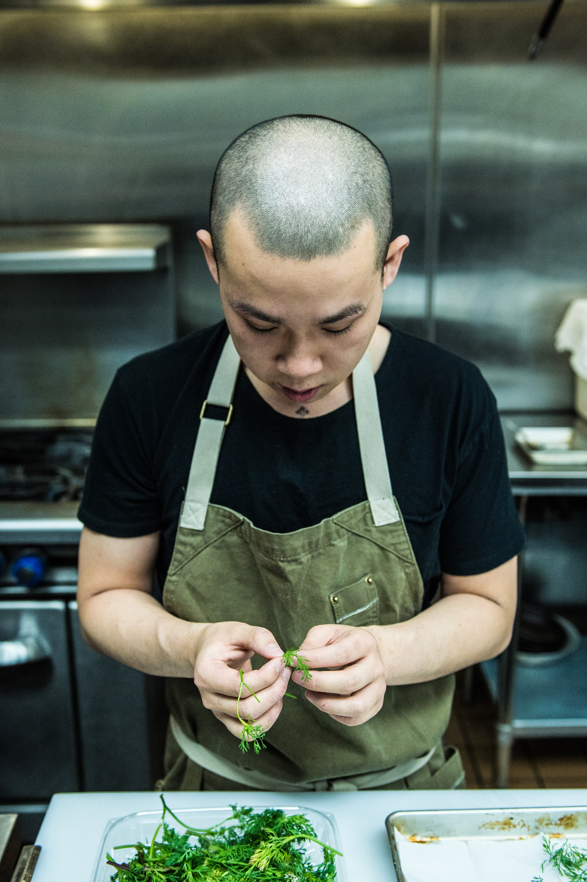 Chef Yao working with some micro greens.