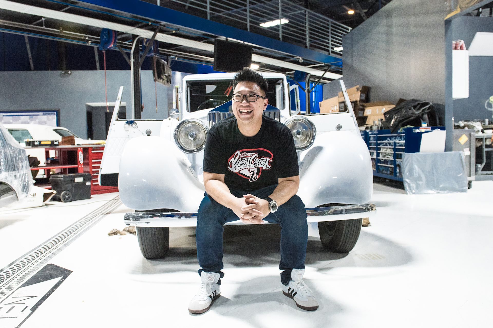 Musa Tjahjono, Head Designer at West Coast Customs, in front of Justin Bieber's Rolls Royce Phantom.