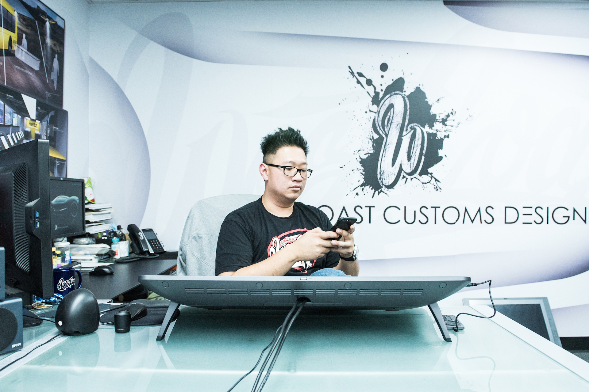 Musa in his office at West Coast Customs.