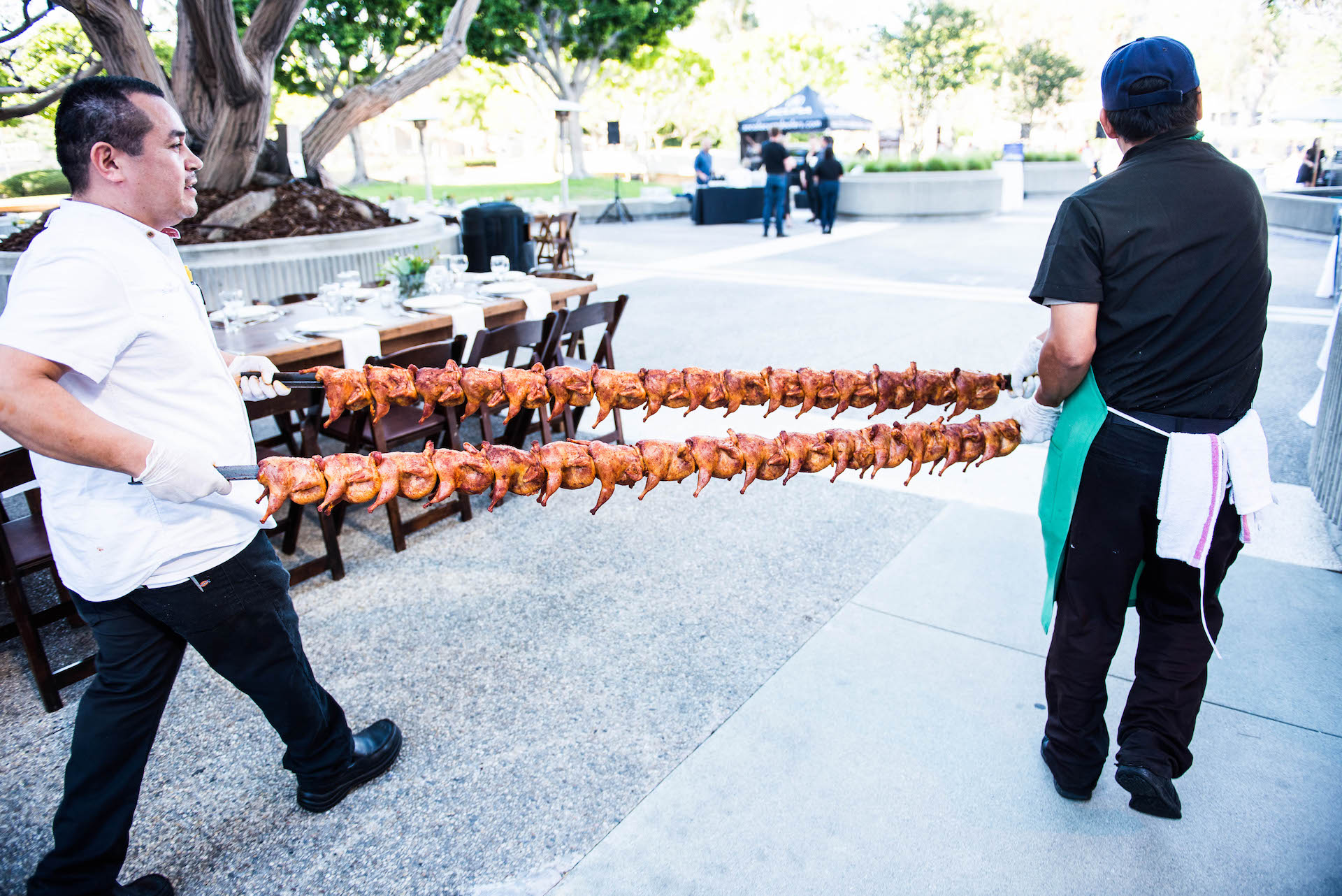 A chicken rack being carried across LA Food Bowl's first Beast Feast.